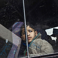 A Palestinian boy looks out of the window of a bus at the checkpoint of Shoafat refugee camp in the outskirts of Jerusalem.
