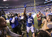 Indianapolis Colts wide receiver Reggie Wayne waves to fans as he leaves the field after the Colts win over the Bengals. Indianapolis hosted Cincinnati in the first round of the NFL Playoffs Sunday, January 4, 2015.
