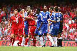 CARDIFF, WALES - SUNDAY, AUGUST 13th, 2006: Liverpool's Bolo Zenden clashes with Chelsea's Michael Essien during the Community Shield match at the Millennium Stadium. (Pic by David Rawcliffe/Propaganda)