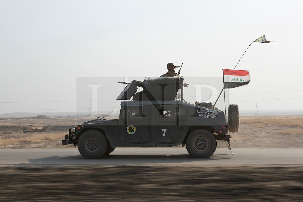 Licensed to London News Pictures. 23/10/2016. An Iraqi Army Humvee races along a recently liberated stretch of  the Erbil to Mosul highway.<br /> <br /> Bartella, a mainly Christian town with a population of around 30,000 people before being taken by the Islamic State in August 2014, was captured two days ago by the Iraqi Army's Counter Terrorism force as part of the ongoing offensive to retake Mosul. Although ISIS militants were pushed back a large amount of improvised explosive devices are still being found in the town's buildings. Photo credit: Matt Cetti-Roberts/LNP