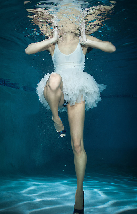 Underwater models pose in clothes for extreme fashion images underwater