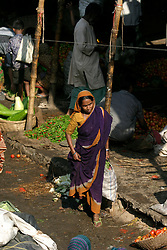 BANGLADESH DHAKA KAWRAN BAZAAR 2MARB05 - A female customer walks throught Kawran Bazaar vegetable market. The Bazaar has been in the Tejgaon area for at least 30 years and is one of the largest markets in Dhaka city...jre/Photo by Jiri Rezac..© Jiri Rezac 2005..Contact: +44 (0) 7050 110 417.Mobile:  +44 (0) 7801 337 683.Office:  +44 (0) 20 8968 9635..Email:   jiri@jirirezac.com.Web:    www.jirirezac.com..© All images Jiri Rezac 2005- All rights reserved.