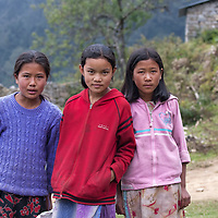 Three girls posing in Melamchi Ghyang.