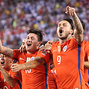EAST RUTHERFORD, NEW JERSEY - JUNE 26: Nicolas Castillo #16 of Chile and Mauricio Pinilla #9 of Chile celebrate victory after their penalty shoot out win during the Argentina Vs Chile Final match of the Copa America Centenario USA 2016 Tournament at MetLife Stadium on June 26, 2016 in East Rutherford, New Jersey. (Photo by Tim Clayton/Corbis via Getty Images)