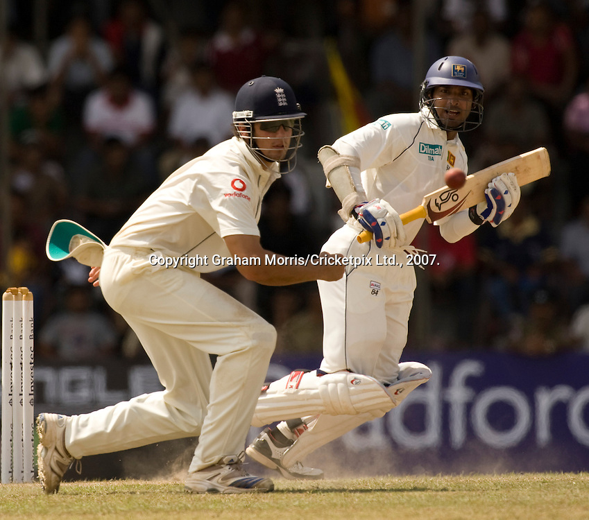Kumar Sangakkara (past close fielder Alastair Cook off Monty Panesar) on the way to his fourth consecutive Test 150 during the first Test Match between Sri Lanka and England at the Asgiriya Stadium, Kandy. Photograph © Graham Morris/cricketpix.com (Tel: +44 (0)20 8969 4192; Email: sales@cricketpix.com)