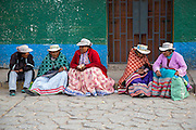 Women are photographed in Chivay, Peru.