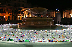 © Licensed to London News Pictures. 14/01/2016. London, UK. Floodlit plastic bottles form a circle around a fountain in Trafalgar Square in an installation by Luzinterruptus called 'Plastic Islands'. Lumiere London is a major new light festival that, over four evenings, brings together<br /> some of the world's most exciting artists working with light utilising large-scale video-mapped projections, interactive pieces and installations. Photo credit: Peter Macdiarmid/LNP