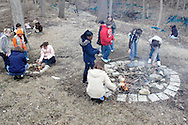 Girl Scouts build fires so they can roast marshmallows and make s'mores during Program Aide (PA) training at the Girl Scouts urban campus in Dayton, Saturday, March 3, 2012.