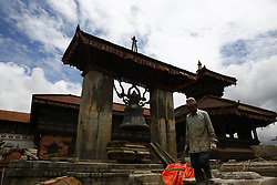 August 3, 2017 - Bhaktapur, Nepal - A worker walks along a damaged temple currently under reconstruction following 2015 earthquake at the ancient city of Bhaktapur Durbar Square, a UNESCO World heritage site in Bhaktapur, Nepal on Thursday, August 03, 2017. (Credit Image: © Skanda Gautam via ZUMA Wire)