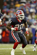 Bills running back Travis Henry (20) rushed for only 67 yards on 24 carries during a 20 to 3  win by the Miami Dolphins over the Buffalo Bills in an NFL Week 16 game in Buffalo on December 21, 2003. ©Paul Anthony Spinelli