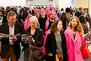 Performers weave throught the crowd joined by a pink ribbon. Frieze London and Frieze Masters 2014, Regents Park, London, 14 Oct 2014.