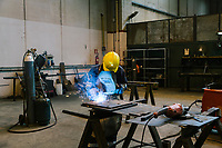 GIOIA TAURO, ITALY - 13 JUNE 2018: A worker weld the part of a locomotive here at Gruppo Ventura,  a family-owned company that installs railroad tracks and does locomotives maintenance,  in Gioia Tauro, Italy, on June 13th 2018.<br /> <br /> Alessandro Ventura, CFO of Gruppo Ventura, traveled there some 20 times over the last three years, establishing a venture with an Iranian company engaged in expanding the national rail network. In March 2017, he signed a 2 million euro contract (about $2.3 million) to service a section of rail outside Teheran.<br /> He shipped two locomotives used to tamp down the rocks below railroad tracks. They went out on a freighter from Gioia Tauro, a port on the Tyrrhenian Sea that has long been notorious as a Mafia-run conduit for cocaine trafficking.<br /> Last August, Mr. Ventura stood at the Iranian port of Bandar Abbas in 122 degree heat, watching a crane hoist the locomotives onto the docks.<br /> Now, those machines are effectively marooned, the business halted. Gruppo Ventura has lost appetite for adventurous expansion.<br /> <br /> Once the Obama administration struck the nuclear deal with Iran three years ago, Italy saw a chance. Last year, Italy exported more than 1.7 billion euros (nearly $2 billion) worth of goods to Iran. Then, President Trump withdrew the United States from the Iran deal and vowed to reinstate sanctions, dealing a blow to companies across Europe — especially those from Italy, Germany and France.