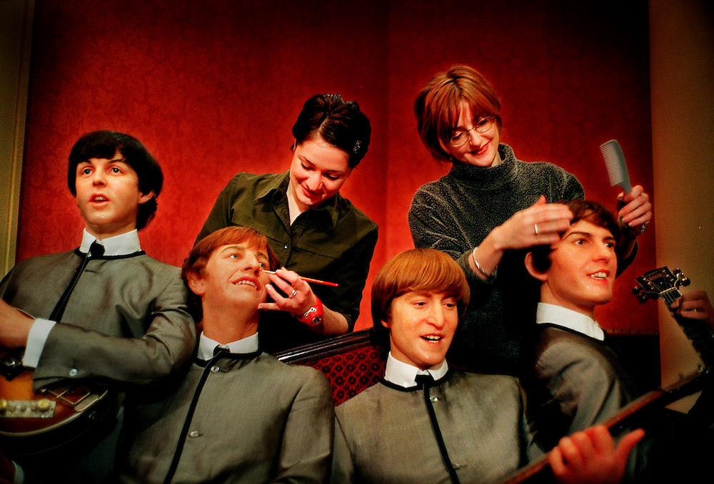 Jo Kinsey (left) and Lisa Hopwood (right), from the Hair and Colour Department at Madame Tussauds - Seen here giving wax effigies The Beatles a last minute tidy up before the opening of Time Magazine's 100 People of the Century exhibit..