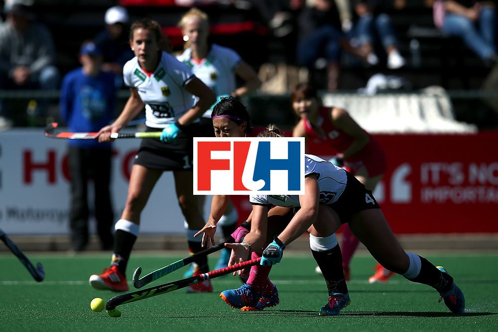 JOHANNESBURG, SOUTH AFRICA - JULY 16:  Nike Lorenz of Germany holds off Kana Nomura of Japan during day 5 of the FIH Hockey World League Women's Semi Finals Pool A match between Japan and Germany at Wits University on July 16, 2017 in Johannesburg, South Africa.  (Photo by Jan Kruger/Getty Images for FIH)