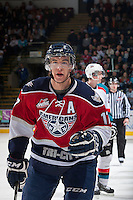 KELOWNA, CANADA - MARCH 23: Philip Tot #17 of the Tri-City Americans skates to the bench to celebrate a goal against the Kelowna Rockets on March 23, 2014 during game 2 of the first round of WHL Playoffs at Prospera Place in Kelowna, British Columbia, Canada.   (Photo by Marissa Baecker/Getty Images)  *** Local Caption *** Philip Tot;