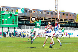May 5, 2013; Bronx, NY; USA; Leitrim's Paul Brennan (10) tries to catch the ball while being defended by New York's C.J. Molloy (9) and Michael O'Regan (3) during the first half at Gaelic Park.