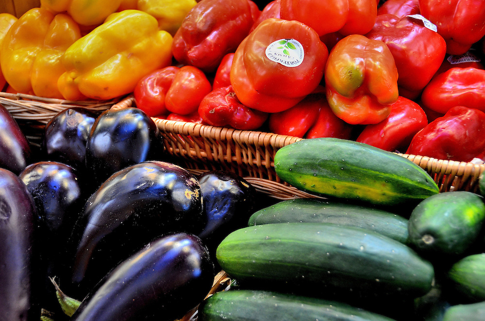 Purple Squash, Cucumbers, Yellow Red Bell Peppers at Farmers Market in Vancouver, Canada