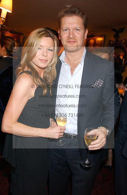 MR &amp; MRS SOREN THOLSTRUP at a dinner hosted by Stratis &amp; Maria Hatzistefanis at Annabel's, Berkeley Square, London on 24th March 2006 following the christening of their son earlier in the day.<br />