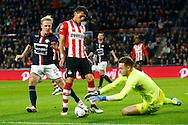 09-04-2016 VOETBAL:PSV:WILLEM II:EINDHOVEN<br /> Jeroen Zoet van PSV pakt de bal voor Hector Moreno van PSV en Nick van der Velden van Willem II <br /> <br /> Foto: Geert van Erven