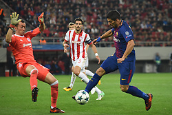 October 31, 2017 - Piraeus, Attica, Greece - Barcelona's Uruguayan forward Luis Suarez (R) vies with Olympiakos' Belgian goalkeeper Silvio Proto during the UEFA Champions League group D football match between FC Barcelona and Olympiakos FC at the Karaiskakis stadium in Piraeus near Athens on October 31, 2017. (Credit Image: © Wassilios Aswestopoulos/NurPhoto via ZUMA Press)