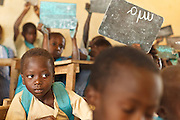 Children attend class at the Faye primary school in the town of Faye, Bas-Sassandra region, Cote d'Ivoire on Monday March 5, 2012. The class has 79 students, and the school has been forced to refuse any additional students.