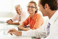 Businesspeople in conference meeting smiling