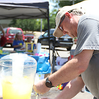 Allen Giglio fixes the lemonade he purchased at Ryleigh Wright's Alex's Lemonade Stand to raise money for St. Jude Children't Research Hospital