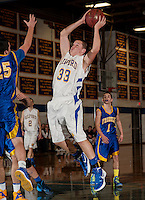 Gilford's Kaleb Orton goes for the basket against Franklin's Bruce Carey during Tuesday night's varsity basketball at Gilford High School.  (Karen Bobotas/for the Laconia Daily Sun)