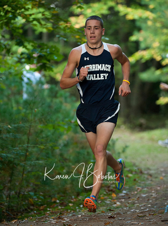 Colton Ham gets into his stride during Tuesday afternoons Cross Country Meet at MVHS.  (Karen Bobotas/for the Concord Monitor)
