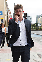 © Licensed to London News Pictures. 15/07/2014. London, UK. William Simpson leaves Thames Magistrates Court in London over alleged racist behaviour on a Paris Metro train in February. He is one of five Chelsea fans facing a Football Banning Order because of alleged racist behaviour on the Paris Metro train. Photo credit : Vickie Flores/LNP
