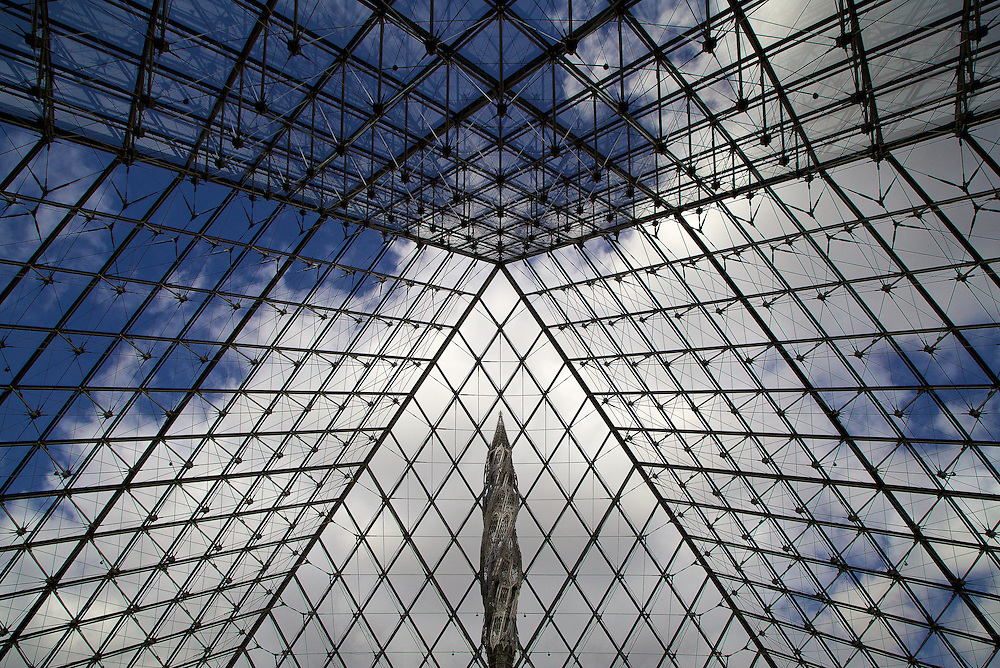 This photo was taken beneath the glass pyramid of the Louvre, Paris. I fell in love with the geometric shapes and symmetry created by all the panes of glass that made me feel like I was standing within an alien ship.