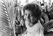 A young boy attending a community festival. Community of Nueva Esperanza, El Salvador, 1999.