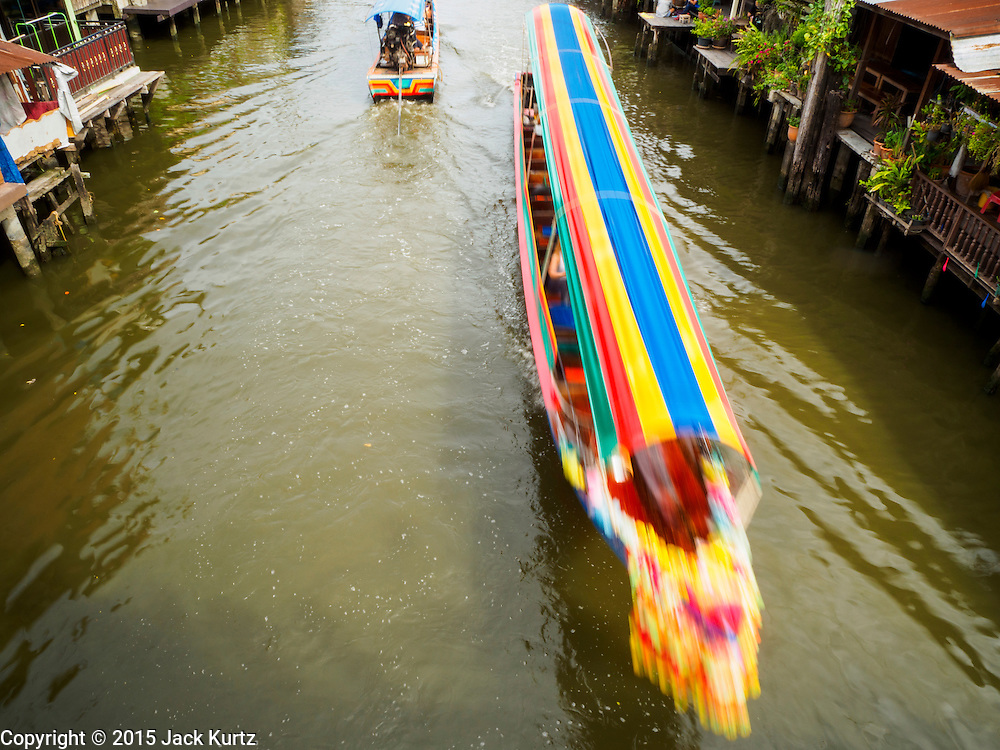 27 JUNE 2015 - BANGKOK, THAILAND:   Boats on Khlong Bang Luang in the Bang Luang neighborhood of the Thonburi section of Bangkok. The Bang Luang neighborhood lines Khlong (Canal) Bang Luang in the Thonburi section of Bangkok on the west side of Chao Phraya River. It was established in the late 18th Century by King Taksin the Great after the Burmese sacked the Siamese capital of Ayutthaya. The neighborhood, like most of Thonburi, is relatively undeveloped and still criss crossed by the canals which once made Bangkok famous. It's now a popular day trip from central Bangkok and offers a glimpse into what the city used to be like.       PHOTO BY JACK KURTZ