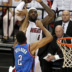 Jun 21, 2012; Miami, FL, USA; Miami Heat small forward LeBron James (6) shoots against Oklahoma City Thunder shooting guard Thabo Sefolosha (2) during the first quarter in game five in the 2012 NBA Finals at the American Airlines Arena. Mandatory Credit: Derick E. Hingle-US PRESSWIRE