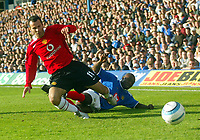 Fotball<br /> Premier League England 2004/2005<br /> Foto: BPI/Digitalsport<br /> NORWAY ONLY<br /> <br /> 30.10.2004<br /> Portsmouth v Manchester United<br /> <br /> Ryan Giggs is tackled by Portsmouths Lomana Lua Lua