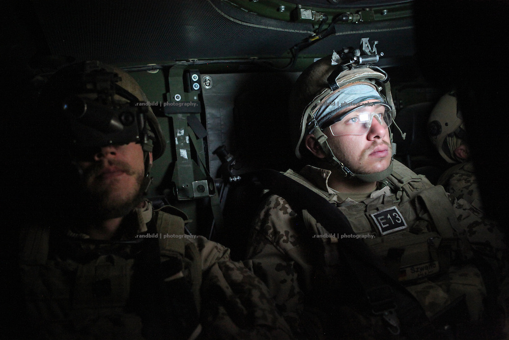 "During a ""Freedom of Movement"" patrol at night a gunner oberves the surroundings by screen, while the other comrade uses night vision gear. In late October 2011 Kunduz based 3.Task Force started a several days operation in and around Nawabad (District Chahar Darah), west of Kunduz, northern Afghanistan. During the Operation Orpheus about 100 german infantery soldiers rolled out for patrols through the town and surrounding areas, which were expected as a retreat zone of insurgents."