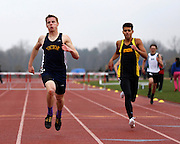 Matt Barton of Victor wins the 400-meter hurdles at the His and Her track and field invitational at Penfield High School on Saturday, April 26, 2014.
