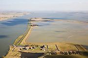 Nederland, Zuid-Holland, Tiengemeten, 04-03-2008; eilandje in het Haringvliet, oorspronkelijk eigendom - binnen de dijken - van AMEV (Fortis Investments),en Natuurmonumenten (buitendijkse slikken); onder in beeld het buurtschap Tiengemeten, met haven voor de pont, links oude dijk (nu de functie van dam) naar overgebleven beorderijen; het eiland werd gebruikt voor de akkerbouw maar is inmiddels 'teruggegeven aan de natuur' (dijken deels doorgestoken) , de laatste boer is in 2006 vertrokken; huidig gebruik onder andere zorgboerderij en kan er gekampeerd worden; nieuwe natuur, onderdeel van de Ecologische Hoofdstructuur; natuurontwikkelingsgebied, natuurontwikkeling natuurontwikkeling; tiengemeenten. .luchtfoto (toeslag); aerial photo (additional fee required); .foto Siebe Swart / photo Siebe Swart
