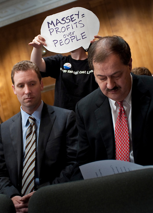 May 20, 2010 - Washington, District of Columbia, U.S., - A protester holds a sign over the head of Don Blankenship, chairman and CEO of Massey Energy Company before his appearance in front of a Senate Appropriations Committee hearing on Mine Safety Investment on Thursday.(Credit Image: © Pete Marovich/ZUMA Press)