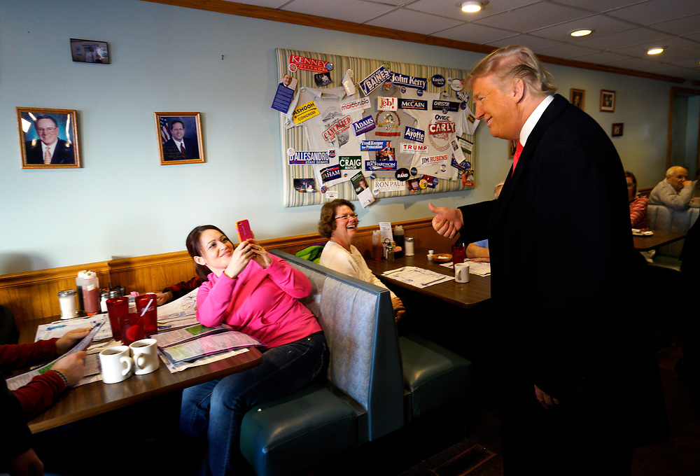 U.S. Republican presidential candidate Donald Trump poses for a photo for a guest at the Chez-Vauchon restaurant in Manchester, New Hampshire February 7, 2016<br />  REUTERS/Rick Wilking