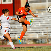 100113  Adron Gardner/Independent<br /> <br /> Grants Pirate Katelyn Michael (16), left,  follows Gallup Bengal Alisha Campos (7) as she attempts a goal kick in Grants Tuesday.