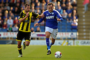 Chesterfield FC miffielder Dan Gardner under pressure for the ball during the Sky Bet League 1 match between Chesterfield and Burton Albion at the Proact stadium, Chesterfield, England on 26 September 2015. Photo by Aaron Lupton.