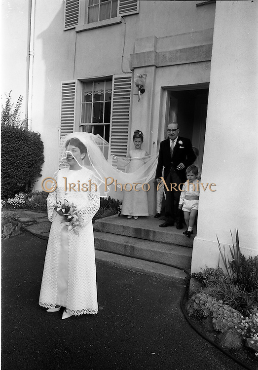 "16/09/1967<br /> 09/16/1967<br /> 16 September 1967<br /> Wedding of Mr Francis W. Moloney, 28 The Stiles Road, Clontarf and Ms Antoinette O'Carroll, ""Melrose"", Leinster Road, Rathmines at Our Lady of Refuge Church, Rathmines, with reception in Colamore Hotel, Coliemore Road, Dalkey. Image shows the bride leaving home before  the ceremony with her father Mr Dudley O'Carroll in the doorway."