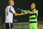 Forest Green Rovers Liam Noble (15) playfully squirts water at Eastleigh's Ryan Cresswell(25) during the Vanarama National League match between Forest Green Rovers and Eastleigh at the New Lawn, Forest Green, United Kingdom on 13 September 2016. Photo by Shane Healey.