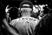 A supporter with a Trump bumper sticker pasted to his back. Anaheim, Calif. May 26, 2016. (Photo by Gabriel Romero ©2016)