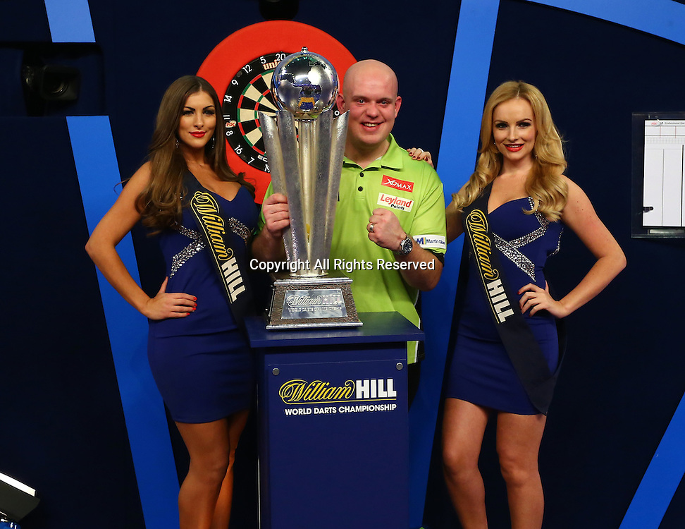 02.01.2017. Alexandra Palace, London, England. William Hill PDC World Darts Championship final  between top seeds Michael van Gerwen (1) and Gary Anderson (2). Michael van Gerwen celebrates winning the World Darts Final and poses with the Trophy and The William Hill Oche Girls, after beating Defending World Champion Gary Anderson 7 sets to 3