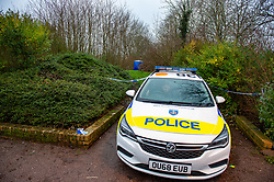 © Licensed to London News Pictures. 12/12/2019. Milton Keynes, UK. A Police vehicle sits across a cordon on a walkway in the Fishermead area after a man was stabbed. Thames Valley Police has launched a murder investigation following the death of a man in Milton Keynes. Police and South Central Ambulance Service attended a woodland in Fishermead, Milton Keynes at around 15:20GMT on Wednesday 11th December 2019 after a report of an altercation between a group of men, during which a man had been stabbed. The victim, a man aged in his twenties died at the scene. Photo credit: Peter Manning/LNP