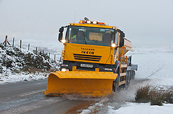 © Licensed to London News Pictures. 07/02/2014. A gritting truck is seen on the road between Builth Wells and Brecon in Powys. 5CM of snow fell on high land in Mid Wales last night and early this morning. Epynt Range, Powys, Wales, UK. Photo credit : Graham M. Lawrence/LNP