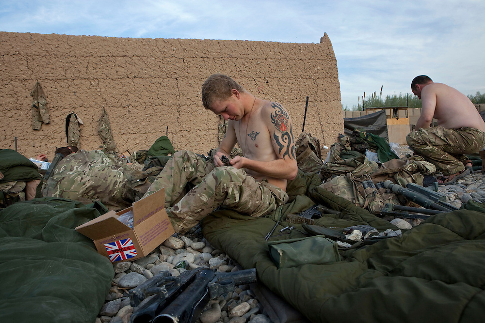 British soldiers from 1PWRR (Princess of Wales's Royal Regiment) live in austere conditions at CP Kareem. During an ongoing series of Operations called Tora Pishaw soldier from other CP's (checkpoints) in the area are also temporarily living in the same small compound. The daily cycle of patrolling, cleaning weapons, trying to dry out uniforms and boots and cooking up rations occupies most of the men's time and there are few  luxuries or distractions. A makeshift gym is the closet thing they have to recreation. CP Kareem, Nad I Ali North, Helmand Province, Afghanistan on the 13th of November 2011.
