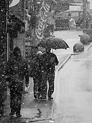Newquay, Cornwall, UK. 6th February, 2018. Unusually heavy snow falls on the north coast od Cornwall. In the town people walk through the heavy snowfall.